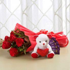 10 red roses,6''teady,2 dairymlk silk